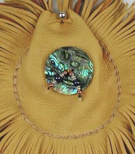 Abalone shell disc used on Apache Medicine Bag