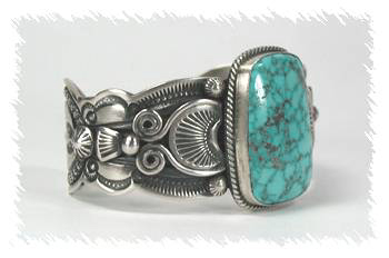 An example of a contemporary Native American bracelet with antiquing