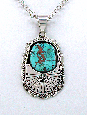 Calendaria Turquoise and Sterling Silver Pendant by Bennie Ration, Navajo