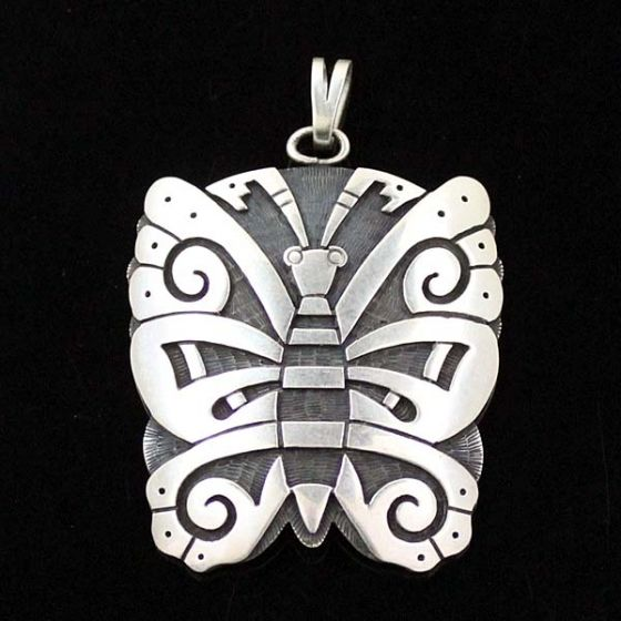 Hopi Butterfly pendant by Kevin Takala. Note the textuized background and silver overlay, typical of Hopi jewelry.7