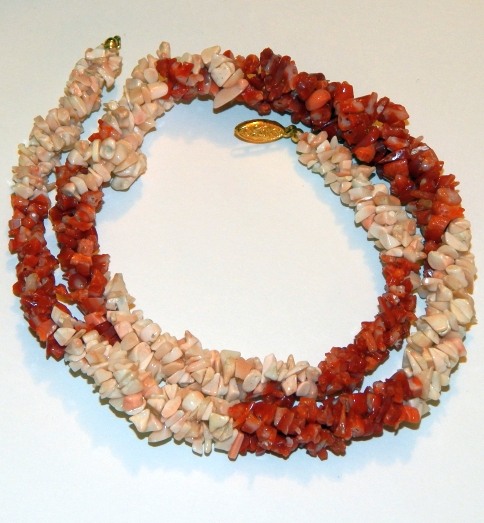 Shell and either dyed shell or possibly coral spring wire bracelet - not Native American made.