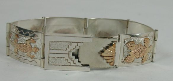 12 K G.F. and STERLING link bracelet with decorative box latch.