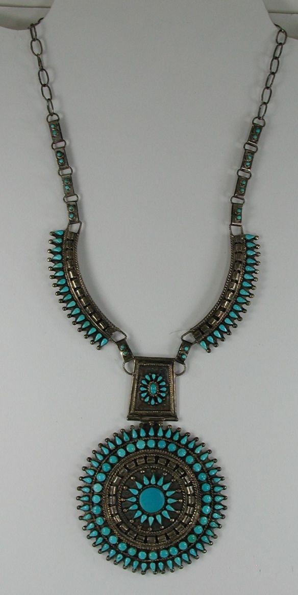 Who made this petit point necklace?